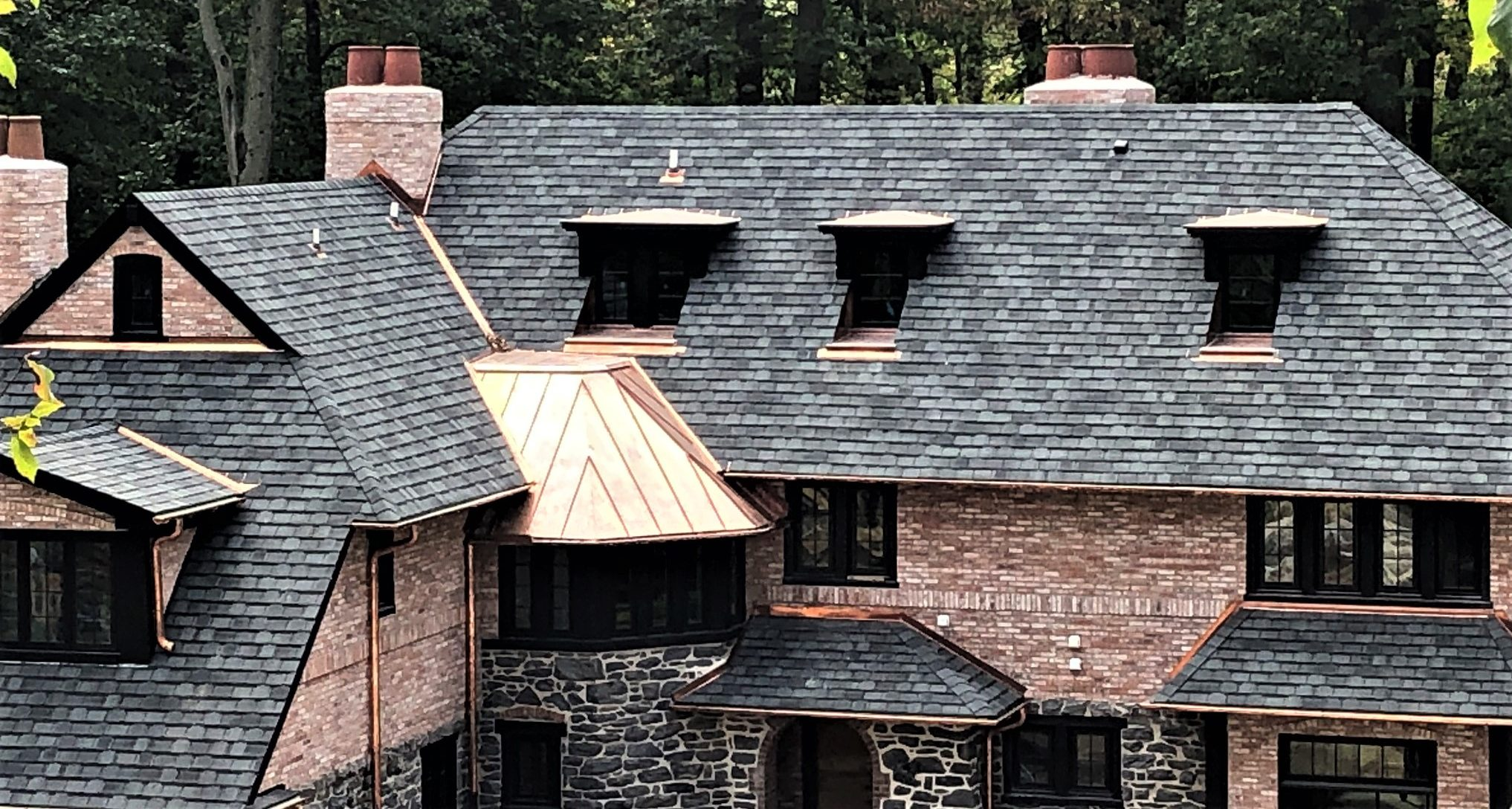 A roof made of shingles and copper