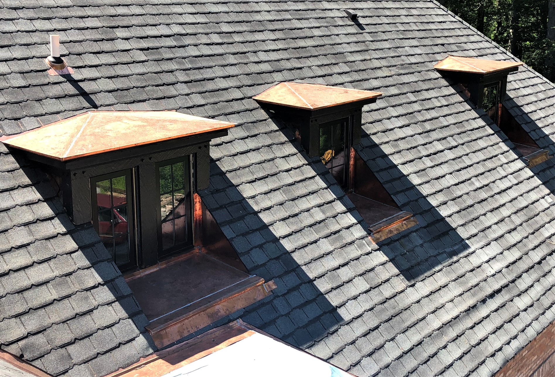 Shingle roof with copper accents