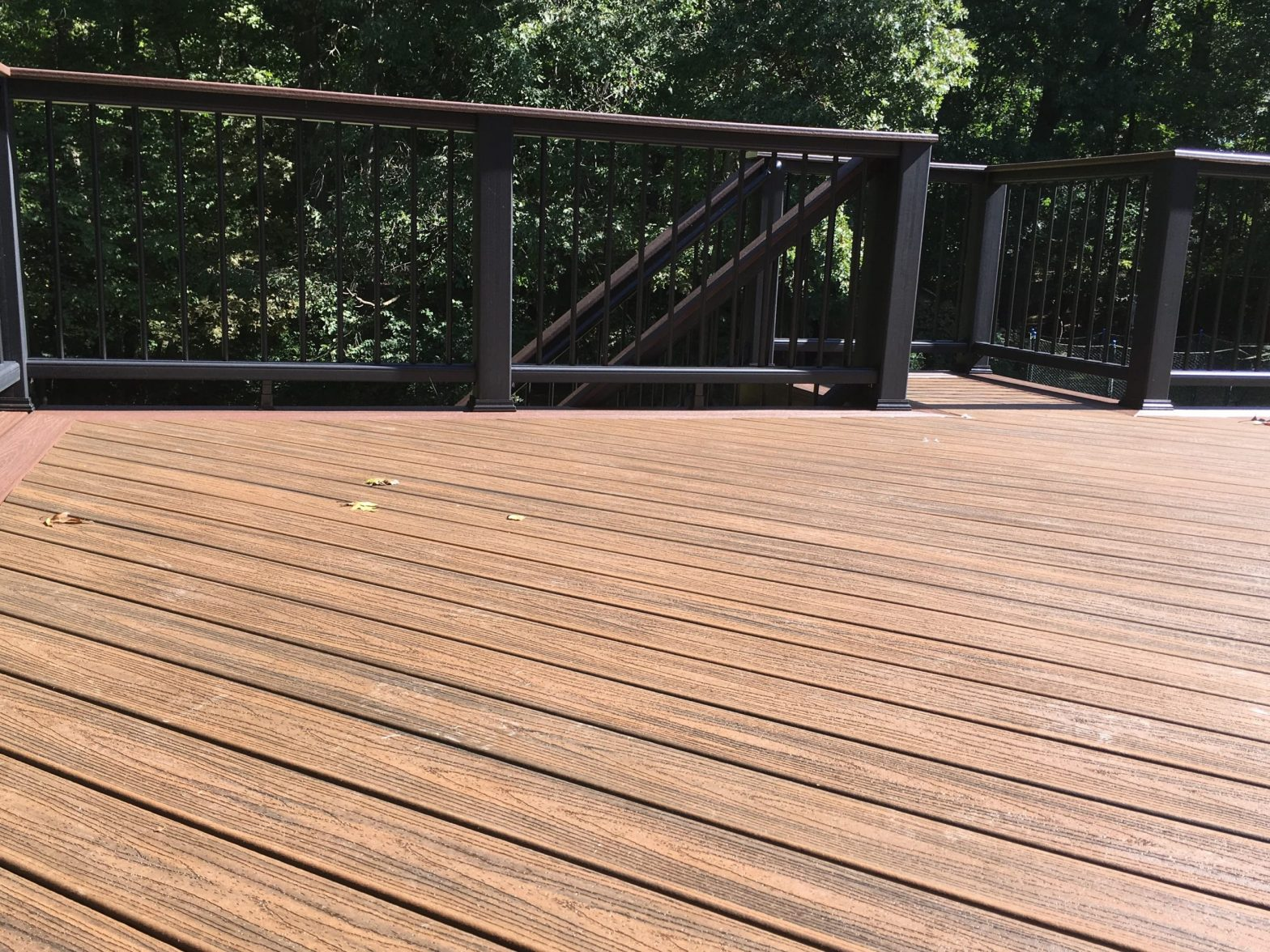 Synthetic brown decking with a black railing