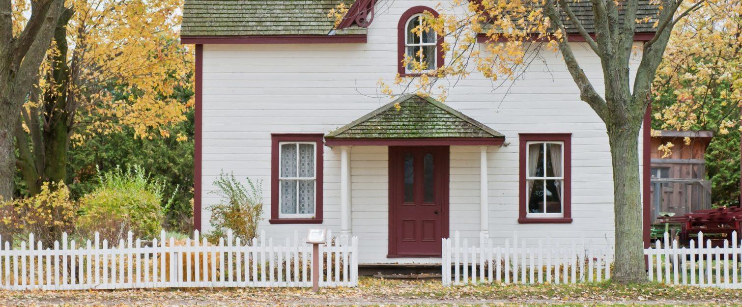 Quaint home among fall foliage